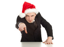 Pointing furious businessman in Christmas hat Stock Photos