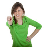 Pointing furious young woman Stock Image