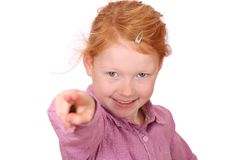 Pointing girl. Portrait of a young red haired girl pointing up Stock Image