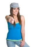 Pointing Girl. Beautiful smiling teen girl pointing Royalty Free Stock Photos