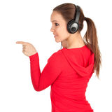 Pointing girl in headphones Royalty Free Stock Image