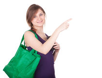 Pointing girl with shopping bag Stock Photo