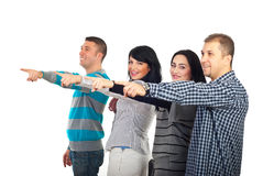 Pointing group of happy people. Group of  happy people friends pointing away to copy space and standing in a line isolated on white background Stock Photos