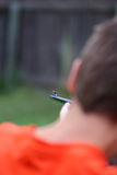 Pointing a Gun. A close up view of a young boy pointing a rifle Stock Photo