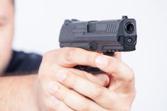 Pointing gun. Focus on the gun Stock Image
