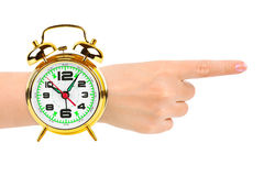 Pointing hand and alarm clock like a watch Royalty Free Stock Photos