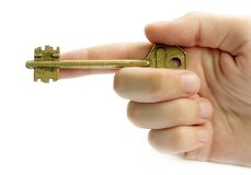 Pointing Hand With A Key. Isolated Over White Royalty Free Stock Image