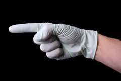 Pointing hand in medical glove Royalty Free Stock Photo