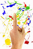 Pointing hand ona painted background Royalty Free Stock Photo