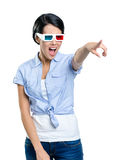 Pointing with hand pretty girl in 3D glasses Stock Photos