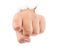Pointing hand punching paper Stock Photo