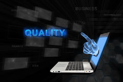 Pointing hand Quality with digital background Stock Photo