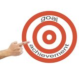 Pointing hand to dart with the word:Goal achievement Stock Image