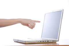 Pointing at laptop. A person pointing at a laptop screen Stock Photo