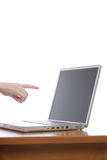 Pointing at laptop. A person pointing at a laptop screen Stock Photos