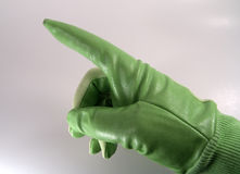 Pointing Left. Photo of Green Glove Pointing Left Stock Image