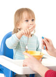 Pointing little boy feeding by his mother Royalty Free Stock Image