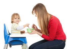 Pointing little boy feeding by his mother Royalty Free Stock Photo