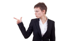 Pointing and looking to the side. Casual young business woman looking, pointing and smiling at copy space Stock Photo