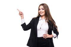 Pointing and looking to the side. Casual young business woman looking, pointing and smiling at copy space. Pointing and looking to the side. Casual young Royalty Free Stock Images