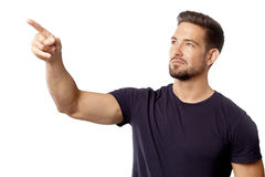 Pointing man. Handsome man pointing with serious expression, a horizontal portrait Stock Photo