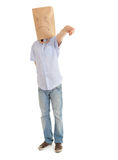 Pointing man with sad paper bag on head Royalty Free Stock Photography