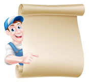 Pointing man scroll. Pointing cartoon mechanic, plumber, handyman, decorator or gardener leaning around a scroll and pointing at it Stock Image