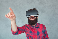 Pointing man in VR headset royalty free stock photography