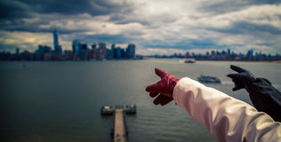 Pointing at Manhattan skyline Royalty Free Stock Photography