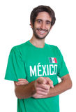 Pointing mexican sports fan with beard Stock Images