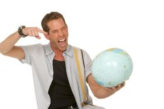 Pointing out adventure. Guy points to a great adventure on the globe Stock Images