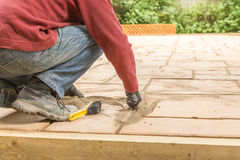 Pointing a patio with dry grouting cement grouting mix Royalty Free Stock Photography