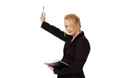 Pointing with Pen. Blond business woman points to the board with pen. Holding report on white background royalty free stock photo