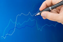 Pointing pen at chart screen Stock Photography