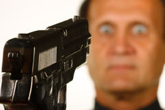 Pointing a pistol at a man Stock Photo
