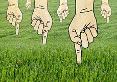 Pointing and Planting Green Hands in Grass Field Stock Photo