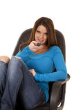 Pointing remote smile Royalty Free Stock Photo