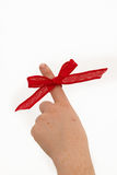 Pointing a ribbon on a finger Royalty Free Stock Image