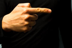Pointing right. Hand pointing right on black background Stock Photos