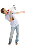 Pointing, screaming man holding megaphone. Screaming young man holding megaphone and pointing, white background Royalty Free Stock Image