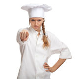 Pointing serious lady cook Stock Photos