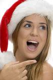 Pointing female with santa cap Royalty Free Stock Image