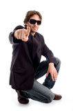 Pointing sitting male Royalty Free Stock Images
