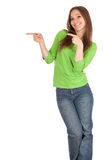 Pointing smiling girl in green blouse Royalty Free Stock Photo