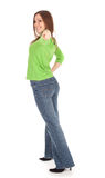 Pointing smiling girl in green blouse Stock Images
