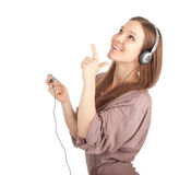 Pointing smiling girl in headphones. And MP3 player Royalty Free Stock Photo