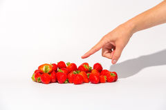 Pointing at strawberries Stock Images