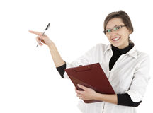 Pointing student girl with clipboard and pen Stock Photos