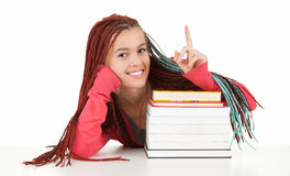 Pointing student woman with braids and boos Royalty Free Stock Image