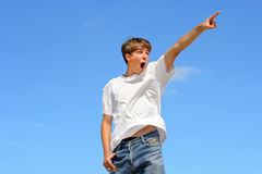 Pointing teenager Stock Images
